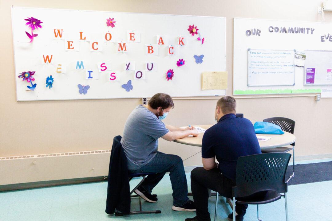 Chrysalis Edmonton staff helping individual